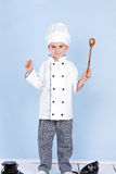 One little boy as chef cook making salad. Stock Images