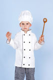 One little boy as chef cook making salad. Royalty Free Stock Photos