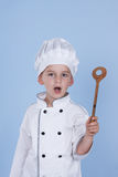 One little boy as chef cook making salad. Royalty Free Stock Photography