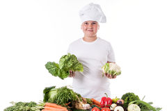 One little boy as chef cook making salad. Stock Photos