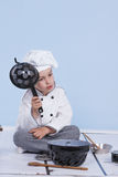 One little boy as chef cook making salad. Royalty Free Stock Images
