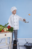 One little boy as chef cook making salad. Royalty Free Stock Photo