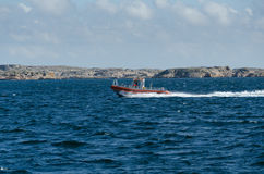One little fast fishingboat on sweden westcoas. T on the way to the harbour Royalty Free Stock Images
