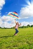 One little girl run with kite Stock Photo