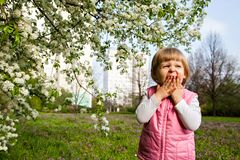 One little girl yawning near tree Royalty Free Stock Images