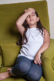 One little middle eastern beautiful small girl sitting feeling bad. Stock Image