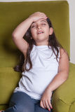 One little middle eastern beautiful small girl sitting feeling bad. Stock Images