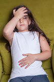 One little middle eastern beautiful small girl sitting feeling bad. She feels cold Stock Image