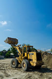 One Loader excavator. Construction machinery  on blue sky Stock Image
