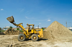 One Loader excavator. Construction machinery  on blue sky Royalty Free Stock Images