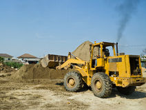 One Loader excavator. Construction machinery  on blue sky Stock Photography
