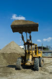 One Loader excavator. Construction machinery  on blue sky Stock Photo