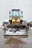 One Loader excavator construction machinery equipment in an industrial zone Stock Images