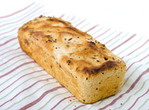 One loaf of bread on tablecloth Stock Photo