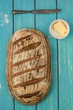 Sourdough bread. One loaf of sourdough bread on blue bable board stock images