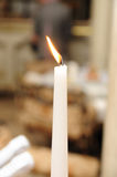 One long candle burning. Long candle with fire burning royalty free stock photo