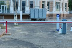 Long closed barrier on asphalt city street by the road. One long closed barrier on asphalt city street by the road royalty free stock image