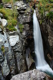 One long waterfall. On the image is narrow waterfall strait in the rock stock photos