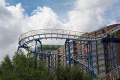 One loop of the roller-coaster. With residential buildings on background Royalty Free Stock Photography
