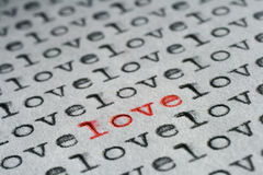 One and only love. Words love written with an old typewriter, one word written in red and standing out. Diagonal composition royalty free stock image