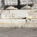 One Love Irony. Sleeping homeless next to a `One Love` graffiti Stock Image
