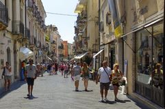 One of the main streets of famous Taormina town in August peak season of 2017er, Sicily, Italy. TAORMINA, ITALY - August 18, 2017: One of the main streets of stock photos