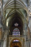 Lincoln Cathedral crazy vaulted ceiling and stained glass window over the main entrance. One major architectural feature of Lincoln Cathedral are the spectacular stock photo