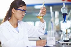 Asian Laboratory scientist working at lab with test tubes. One male Chinese Laboratory scientist working at lab with test tubes Stock Image