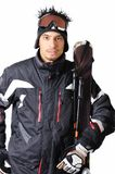 One male skier posing with full equipment on a white background. One male skier posing on a white background Royalty Free Stock Photo