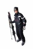 One male skier posing with full equipment on a white background Royalty Free Stock Photos