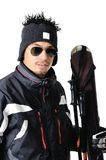One male skier posing with full equipment on a white background. One male skier posing on a white background Royalty Free Stock Images