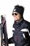 One male skier posing with full equipment on a white background. One male skier posing on a white background Royalty Free Stock Image