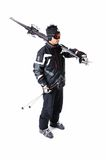 One male skier showing how to carry full equipment. One male skier on a white background Royalty Free Stock Image