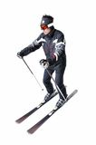 One male skier skiing with full equipment on a white background. One male skier skiing on a white background Stock Images