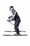One male skier skiing with full equipment on a white background. One male skier skiing on a white background Royalty Free Stock Photography