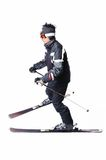 One male skier skiing with full equipment on a white background. One male skier skiing on a white background Stock Image