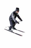 One male skier skiing with full equipment on a white background. One male skier skiing on a white background Royalty Free Stock Photos