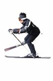 One male skier skiing with full equipment on a white background. One male skier skiing on a white background Royalty Free Stock Images