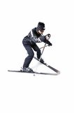 One male skier skiing with full equipment on a white background. One male skier skiing on a white background Stock Photo