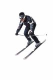 One male skier skiing with full equipment on a white background. One male skier skiing on a white background Royalty Free Stock Image