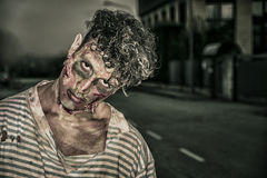 One male zombie standing in empty city street on Halloween Royalty Free Stock Photos