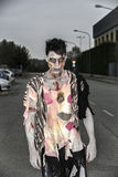 One male zombie standing in empty city street on Halloween Stock Photos