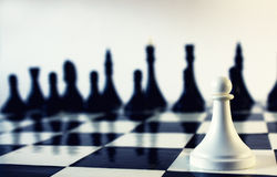 One man army. One pawn against the whole chess army. There is text-space on the left Royalty Free Stock Image