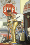 A one-man band in a gold lame costume stock images