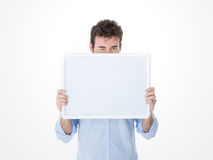 One man behind an empty board making a wink Royalty Free Stock Images