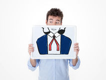 One man completes his face with a drawing Royalty Free Stock Photography