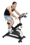 One man doing indoor biking exercise. On white background Stock Image