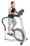 One man doing step machine exercise Stock Photography