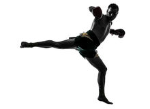 One man exercising thai boxing silhouette Stock Photos