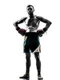 One man exercising thai boxing silhouette. One caucasian man exercising thai boxing in silhouette studio  on white background Stock Image